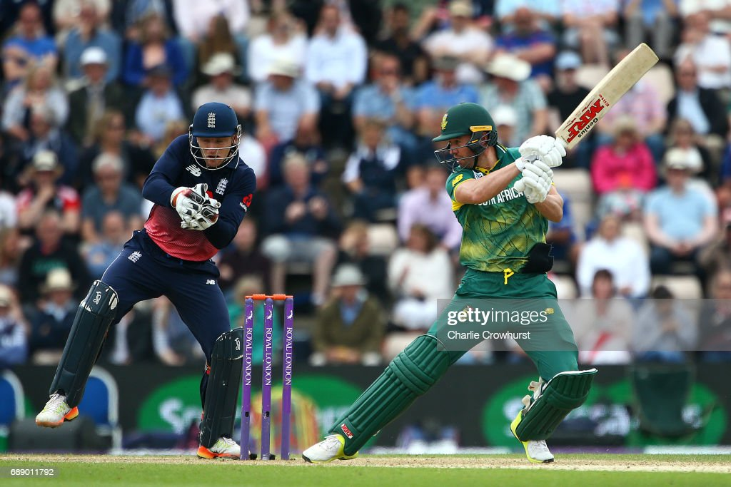 South Africa's AB de Villiers hits out while England wicket keeper Jos Butler looks on during the Royal London ODI match between England and South Africa at The Ageas Bowl on May 27, 2017 in Southampton, England.