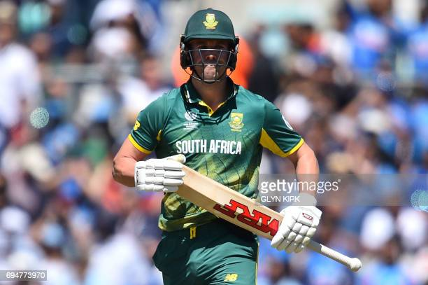 South Africa's AB de Villiers leaves the field after being run out for 16 during the ICC Champions Trophy match between South Africa and India at The...