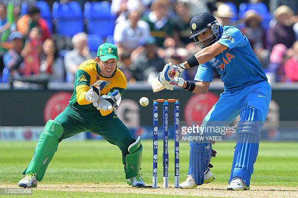 South Africa's AB de Villiers looks on as India's Virat Kohli bats during the 2013 ICC Champions Trophy cricket match between India and South Africa...
