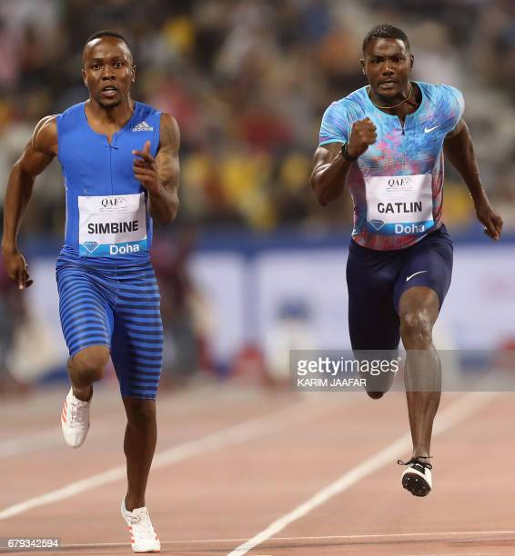 South Africa's Akani Simbine and US' Justin Gatlin compete in the men's 100 metres during the Diamond League athletics competition at the Suhaim bin...
