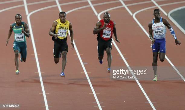 South Africa's Akani Simbine Jamaica's Julian Forte Switzerland's Alex Wilson Britain's Reece Prescod compete in the heats of the men's 100m...