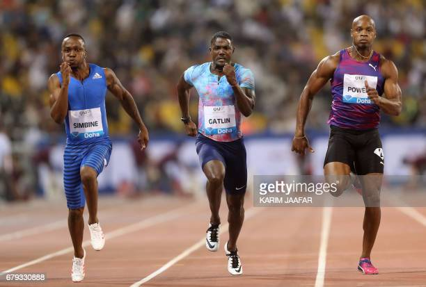 CORRECTION South Africa's Akani Simbine US' Justin Gatlin and Jamaica's Asafa Powell compete in the men's 100 metres during the Diamond League...