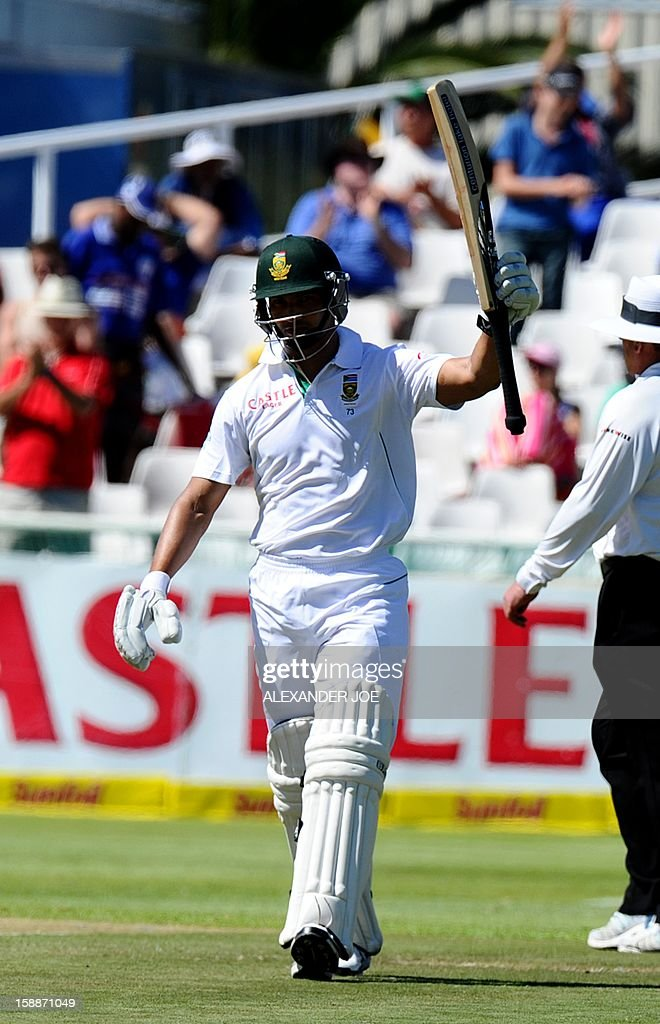 South Africa's Alviro Petersen raises his bat after scoring a half century (50 runs) during day one of the first Test match between South Africa and New Zealand, in Cape Town at Newlands on January 2, 2013. AFP PHOTO / ALEXANDER JOE