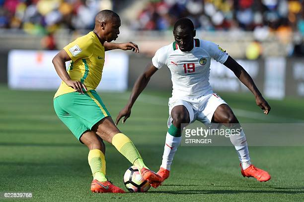South Africa's Andile Jali passes Senegal's Saliou Ciss during the 2018 World Cup qualifying football match between South Africa and Senegal on...