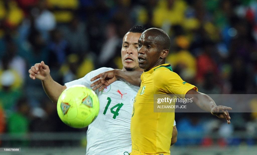South Africa's Anele Ngcongca (R) vies for the ball with Algeria's Foued Kadir during a friendly football match between South Africa's Bafana Bafana and Algeria in Soweto on January 12 , 2013, ahead of the 2013 African Cup of Nations that will take place in South Africa from January 19 to February 10.