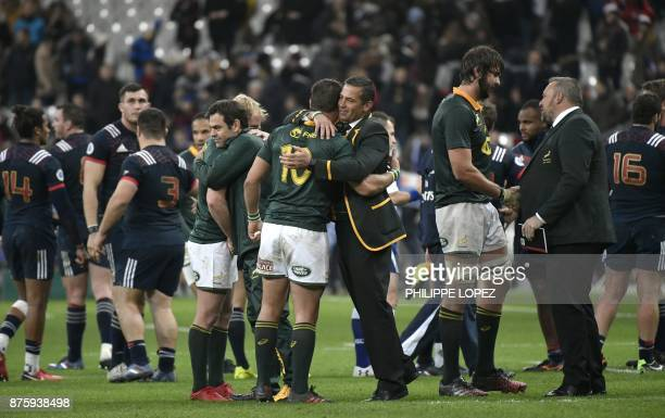 South Africa's assistant coach Franco Smith embraces South Africa's flyhalf Handre Pollard after victory in the friendly rugby union international...