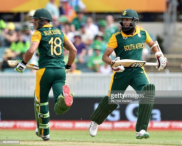 South Africa's batman Faf du Plessis runs with teammate Hashim Amla during the 2015 Cricket World Cup Pool B match between Ireland and South Africa...