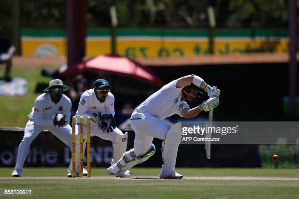 South Africa's batsman Dean Elgar hits a ball during the first day of the second cricket Test Match between South Africa and Bangladesh in...