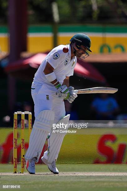 South Africa's batsman Dean Elgar is hit on his right shoulder during the first day of the second cricket Test Match between South Africa and...