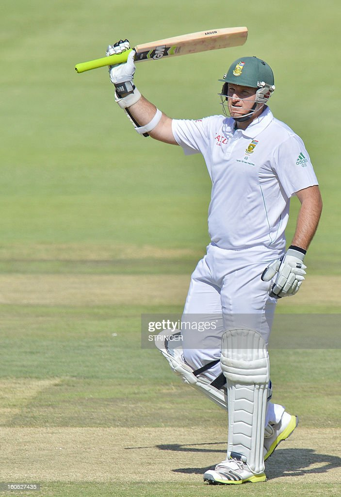 South Africa's batsman Graeme Smith celebrate his 50 runs on day two of the first Test match between South Africa and Pakistan at Wanderers Stadium in Johannesburg on February 2, 2013.