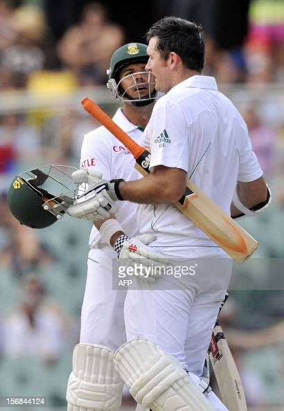 South Africa's batsman Graeme Smith celebrates his 100 runs with teammate Jacobus Ruldolf on the second day of the second cricket Test match at the...