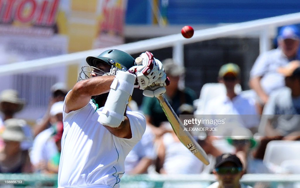 South Africa's batsman Hashim Amla tries to play a high shot during day one of the first Test match between South Africa and New Zealand in Cape Town at Newlands on January 2, 2013. New Zealand were dismissed for 45.