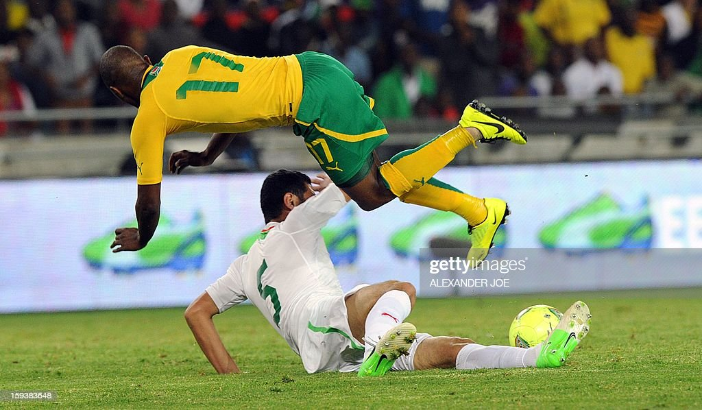 South Africa's Bernard Parker (L) flies over Algeria's Rafik Halliche during a friendly football match between South Africa's Bafana Bafana and Algeria in Soweto on January 12 , 2013, ahead of the 2013 African Cup of Nations that will take place in South Africa from January 19 to February 10. Hosts South Africa completed their warm-up matches for the 2013 Africa Cup of Nations with another disappointing result after being held 0-0 by fellow qualiers Algeria.