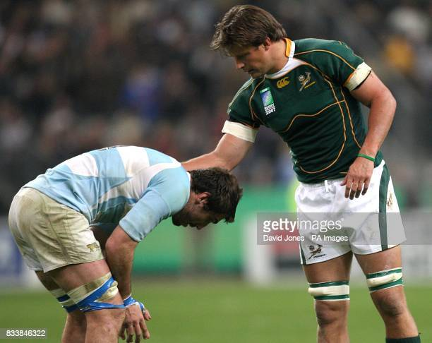 South Africa's Bismarck du Plessis consoles Argentina's Juan Martin Lobbe after the final whistle
