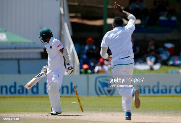 South Africa's bowler Andile Phehlukwayo celebrates after the dismissal of Bangladesh's batsman Liton Das during the third day of the second Test...