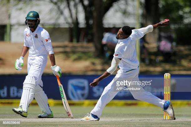 South Africa's bowler Andile Phehlukwayo delivers a ball during the third day of the second Test cricket match between South Africa and Bangladesh in...