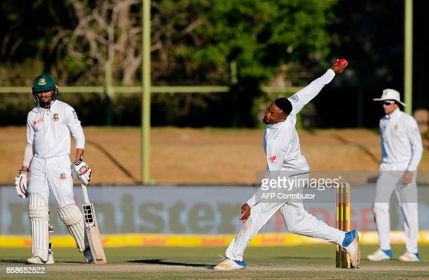 South Africa's bowler Andile Phehlukwayo delivers the ball during the second day of the second Test cricket match between South Africa and Bangladesh...