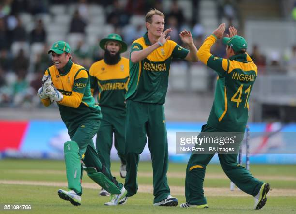 South Africa's bowler Chris Morris celebrates taking the wicket of Pakistan batsman Muhammad Hafeez during the ICC Champions Trophy match at...