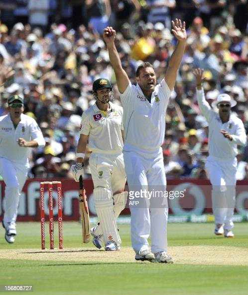 South Africa's bowler Jacques Kallis celebrates the dismissal of Australia's batsman Ed Cowan on the first day of the second Test match at the...