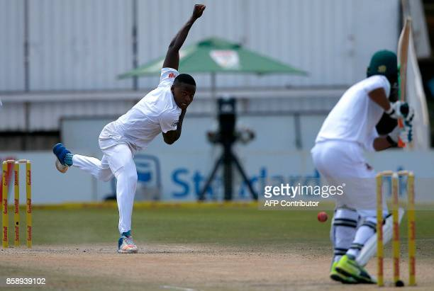 South Africa's bowler Kagiso Rabada delivers a ball to Bangladesh Mahmudullah to take his 100th Test match wicket during the third day of the second...