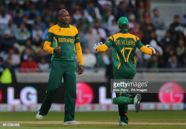 South Africa's bowler Lonwabo Tsotsobe celebrates with captain AB de Villiers after taking the wicket of Pakistan batsman Misbah during the ICC...