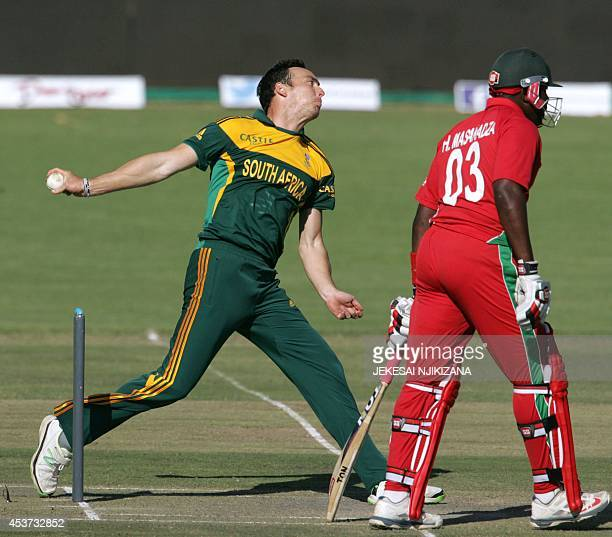 South Africa's bowler Marchant de Lange bowls next to Zimbabwe's bartsman Hamilton Masakadza during the first cricket match of a threematch series of...