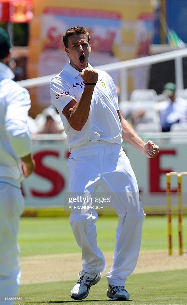 South Africa's bowler Morne Morkel (L) celebrates celebrates his second wicket of New Zealand, on day one of the first Test match between South Africa and New Zealand at Newlands in Cape Town on January 2, 2013.