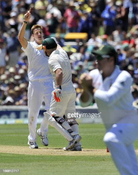 South Africa's bowler Morne Morkel celebrates the dismissal of Australia's batsman David Warner on the first day of the second cricket Test match at...