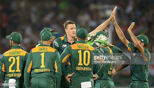 South Africa's bowler Morne Morkel celebrates with teammates after the dismissal of India's batsman Shikhar Dhawan during the third one day...