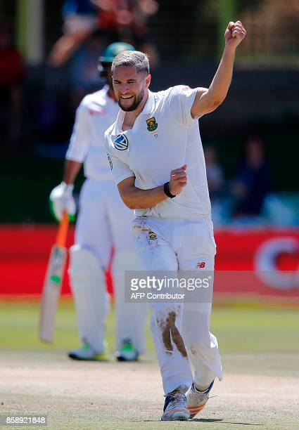 South Africa's bowler Wayne Parnell celebrates after the dismissal of Bangladesh's batsman Mushfiqur Rahim during the third day of the second Test...
