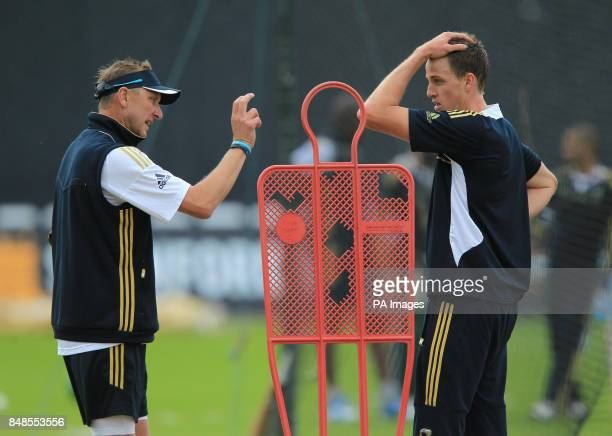 South Africa's bowling coach Allan Donald speaks with Morne Morkel during a nets session at Trent Bridge Nottingham