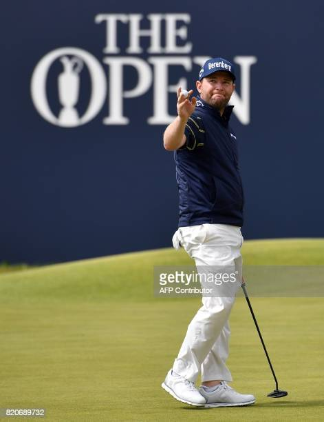 South Africa's Branden Grace reacts after holing out on the 18th green after his third round 62 on day three of the Open Golf Championship at Royal...