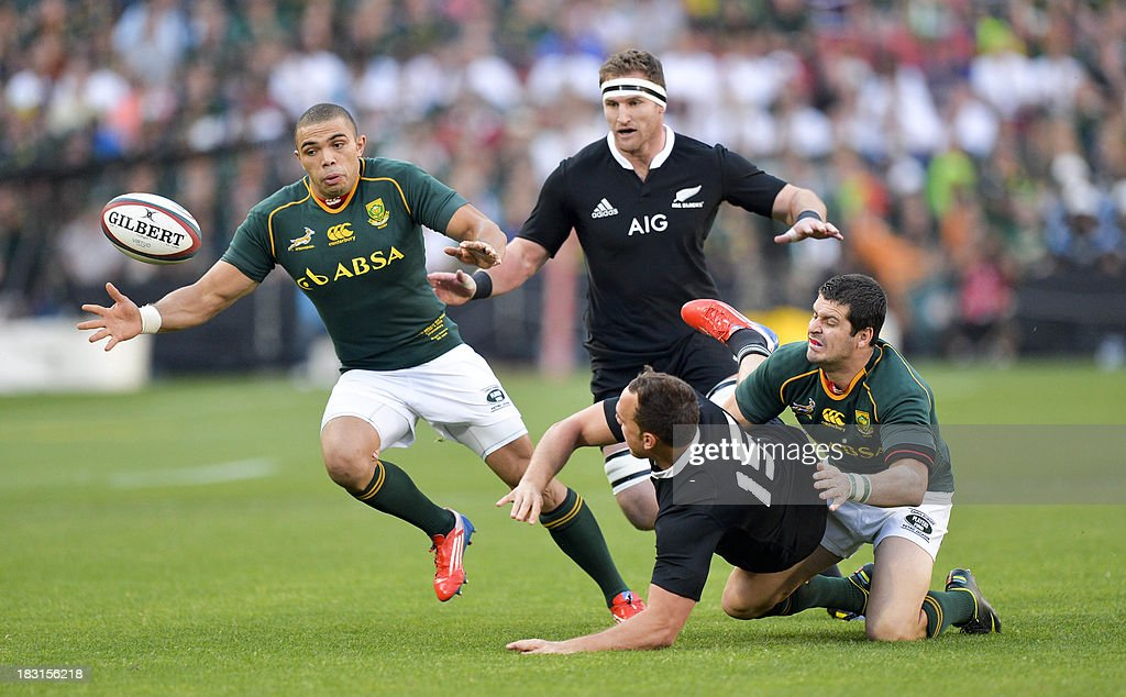 South Africa's Bryan Habana (R) vies with New Zealand's Israel Dagg (c) during the 2013 Rugby union test match South Africa vs New Zealand on October 5, 2013 at the Ellis Park Stadium in Johannesburg.
