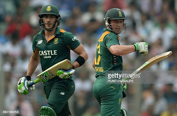 South Africa's captain AB de Villiers and Faf du Plessis run between the wickets during the fifth one day international cricket match between India...