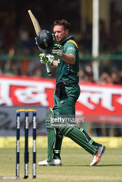 South Africa's captain AB de Villiers celebrates after scoring a century during the first one day international cricket match between India and South...