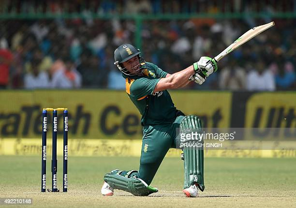 South Africa's captain AB de Villiers plays a shot on his way to scoring a century during the first one day international cricket match between India...