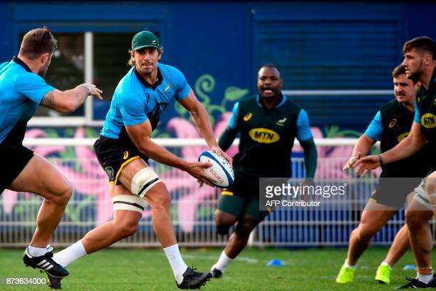 South Africa's captain and lock Eben Etzebeth passes the ball during a training session at the Stade du Saut du Loup Stadium in Paris on November 13...