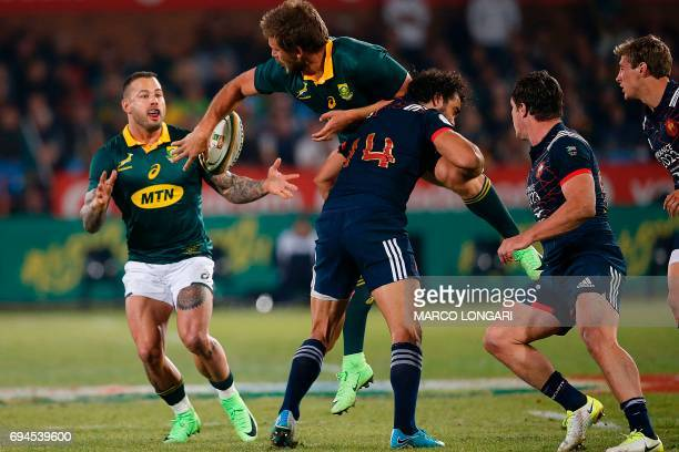 South Africa's captain and number eight Warren Whiteley passes the ball to South Africa scrumhalf Francois Hougaard while being tackled by France's...