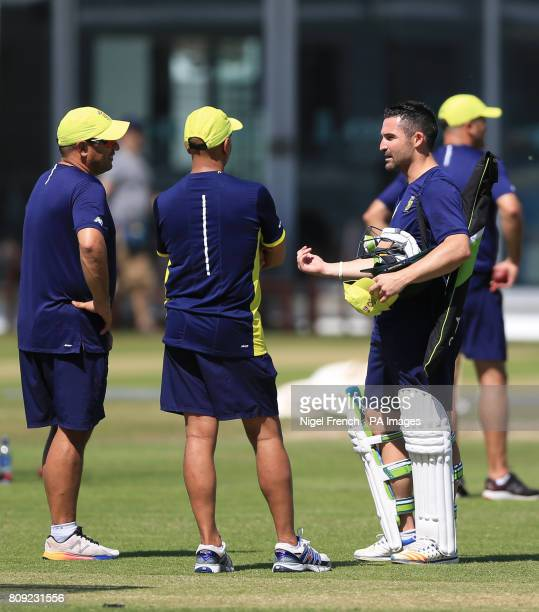 South Africa's captain Dean Elgar talks to head coach Russell Domingo during the nets session at Lord's London