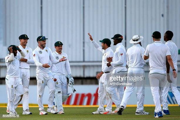 South Africa's captain Faf du Plessis celebrates with teammates after taking a catch to dismiss unseen Bangladesh batsman Liton Das during the second...