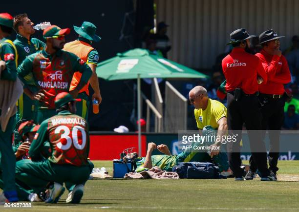 South Africa's captain Faf du Plessis is treated after being injury during their ODI oneday international match at the Buffalo Park Cricket Grounds...