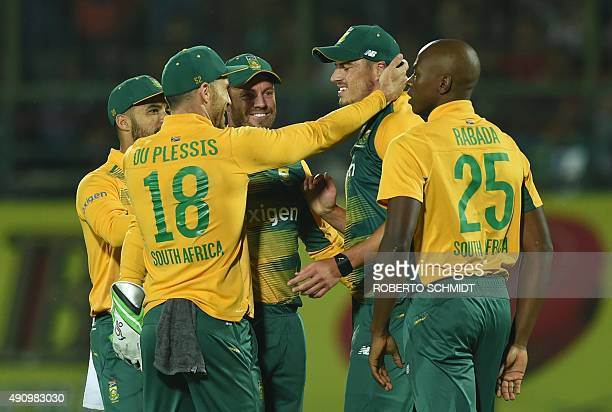 South Africa's captain Faf du Plessis leads teammates as they congratulate Marchant de Lange after his part in the run out of India's Shikhar Dhawan...