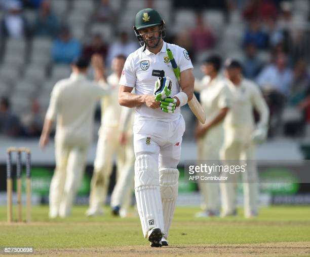South Africa's captain Faf du Plessis leaves the pitch after being dismissed on day 4 of the fourth Test match between England and South Africa at...