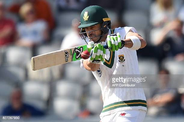 South Africa's captain Faf du Plessis plays a shot on day 4 of the fourth Test match between England and South Africa at Old Trafford cricket ground...
