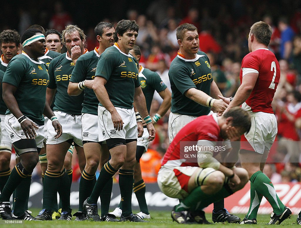 South Africa's captain John Smit (L) shakes hands with Wales' hooker Matthew Rees (R) after winning an international friendly rugby match at the Millennium Stadium in Cardiff, Wales on June 5, 2010.