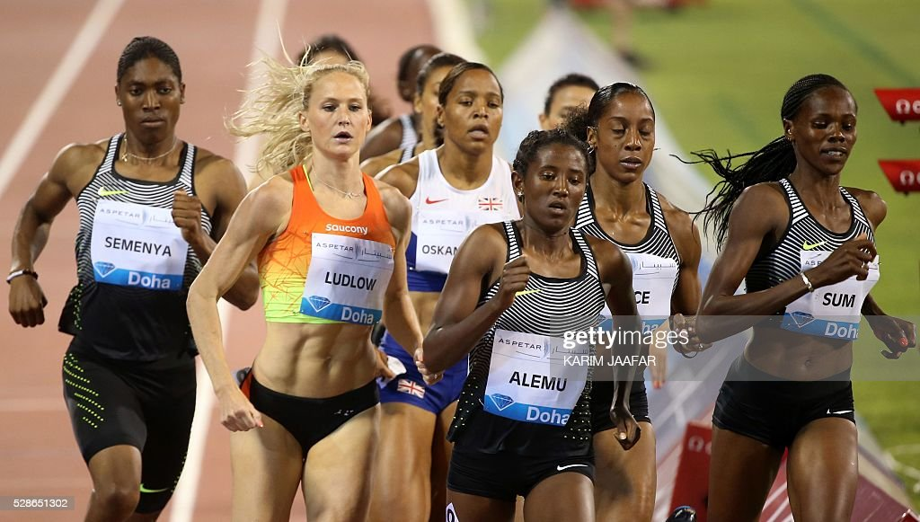 South Africa's Caster Semenya (L) runs in the pack to win the women's 800 metres final at the Diamond League athletics meeting at the Suhaim bin Hamad Stadium in Doha on May 6, 2016. / AFP / KARIM
