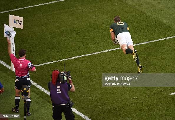 South Africa's centre and captain Jean de Villiers jumps to score his team's second try which was later disallowed during the Pool B match of the...