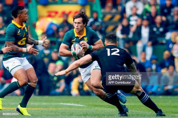 South Africa's centre Jan Serfontein attempts to outrun New Zealand's centre Sonny Bill Williams during the Rugby test match between South Africa and...