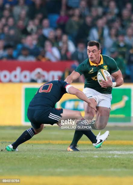 South Africa's centre Jesse Kriel is tackled by France's flyhlaf Jules Plisson during the first rugby union Test match between South Africa and...