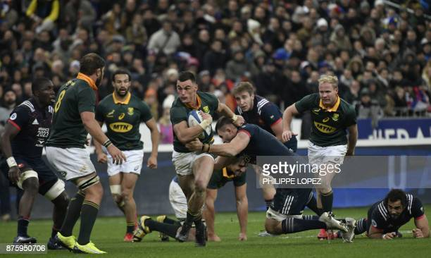 South Africa's centre Jesse Kriel runs with the ball during the friendly rugby union international Test match between France and South Africa's...
